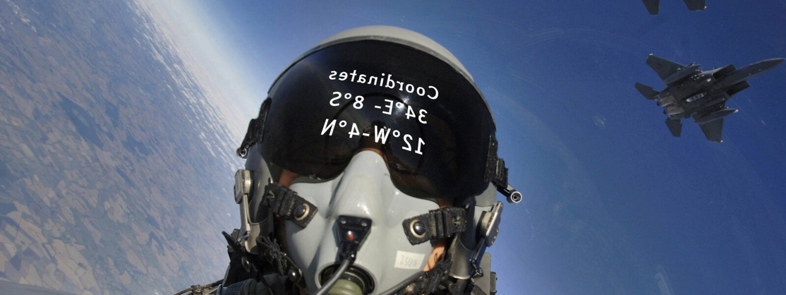 060803-F-2907C-107  	U.S. Air Force Master Sgt. Lance Cheung photographs himself and a three-ship formation of F-15E Strike Eagle aircraft from Royal Air Force Lakenheath, England, on Aug. 3, 2006.  The Strike Eagles are attached to the 492nd Fighter Squadron and are practicing basic surface attack techniques.  Cheung is a photojournalist for the Air Force News Agency in San Antonio, Texas.  DoD photo by Master Sgt. Lance Cheung, U.S. Air Force.  (Released)
